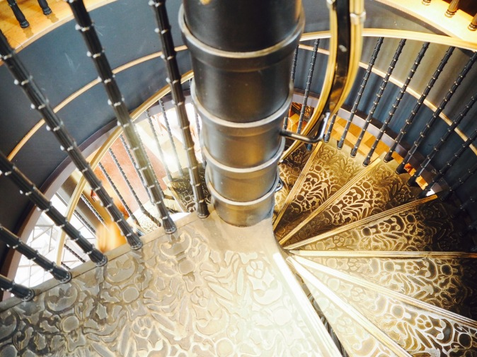 Luxurious gold and black spiral staircase