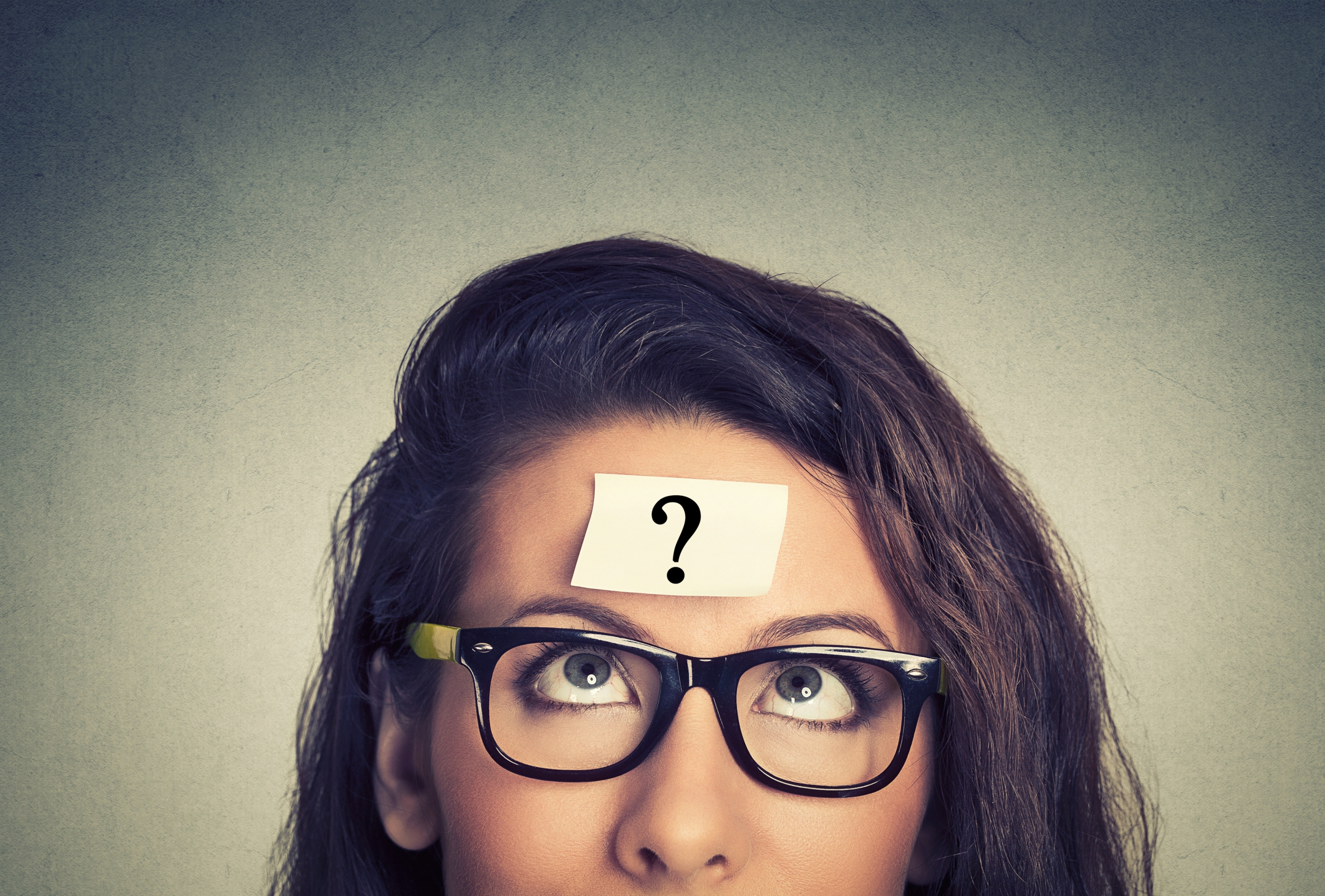 Woman thinking with a question mark on her head