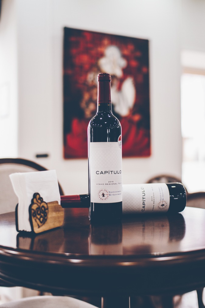 2 bottles of red wine on a table