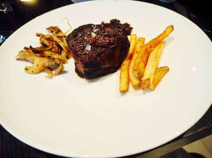 Steak with fries and oyster mushrooms