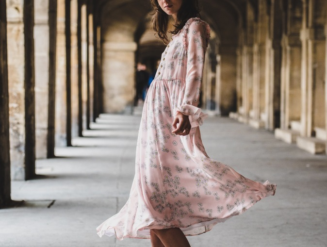 Girl in pink flowery long dress