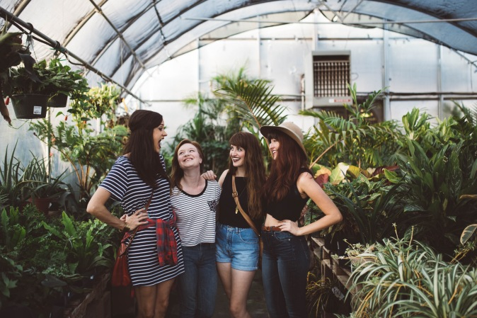 Group of happy girls surrounded by plants